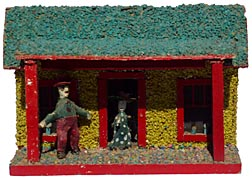 Model cabin with carved couple