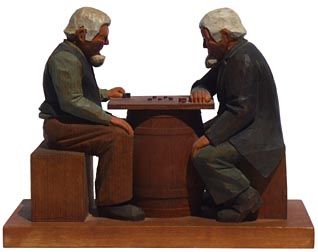 Carving of men playing checkers