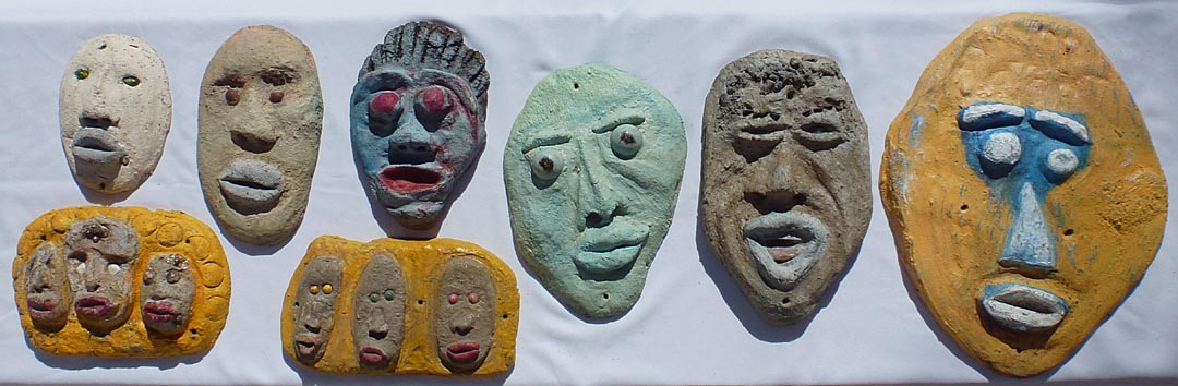 Outsider art concrete faces