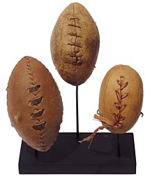 Three miniature footballs