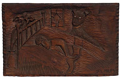 Carving of sleeping man with dog